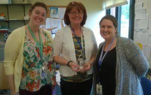 Three members of Somersworth's Next Steps NH Leadership Team receiving an award