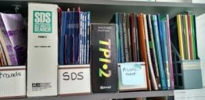 bookshelf of assessment books