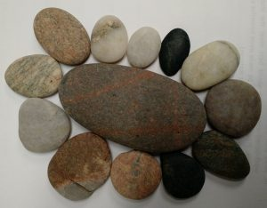 small stones surrounding a larger stone